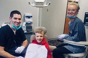 Hygienists working with young patient