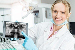 Dentist showing digital x-ray