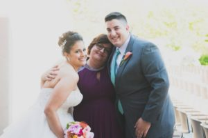 Dr. Mimi Mebarek Long captures a memory with mom and brother during her wedding celebration