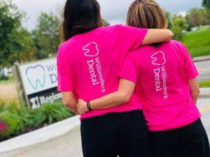 Two women hugging outside.