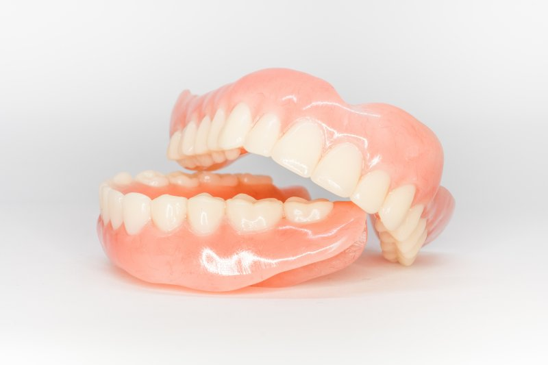a top and bottom denture sitting on a table