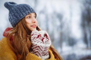 woman out in the cold with winter mouth issues