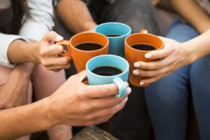 friends drinking coffee together